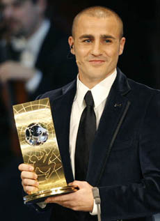 Cannavaro of Italy shows his trophy during the FIFA World Player Gala in Zurich